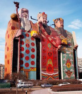 This is China's Tianzi Hotel. The three depictions are the Chinese gods of good fortune and longevity.